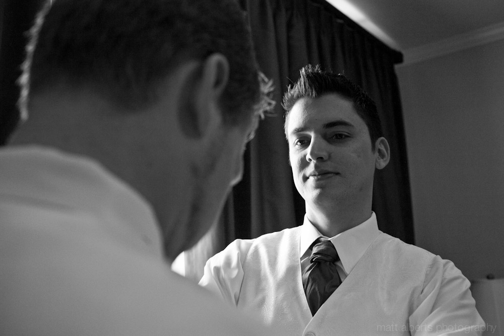 The Best Man helping the groom ger ready